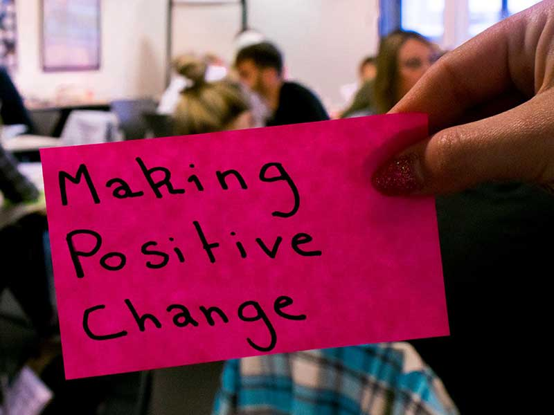 Making positive change on a pink post-it note